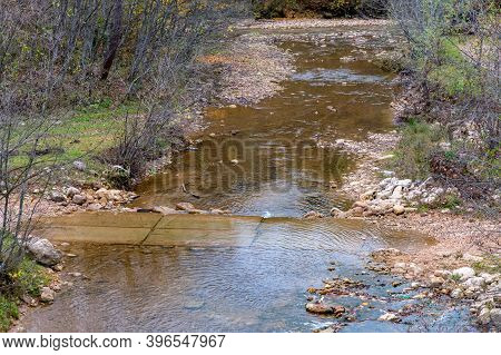Autumn Landscape With Mountain Dry Brook With Rapids And Forest
