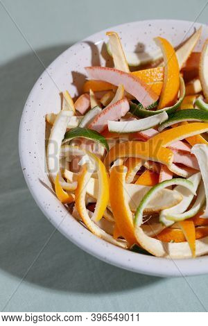 Sliced Citrus Fruit Peel For Cooking Candied On White Plate Close-up. Concept Reducing Food Waste