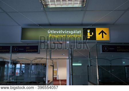 Budapest, Hungary - Circa 2020: Signs for passport control at Budapest airport Terminal 1. Hungarian text translates to Passport Control, just as written below it in English. Terminal 1 is out of use