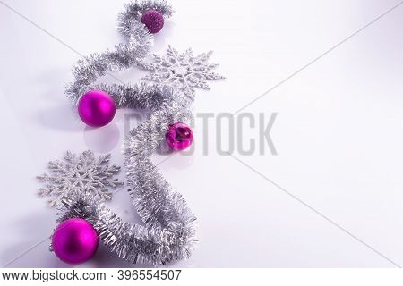 Christmas Flatlay With Purple Decorations On White Background