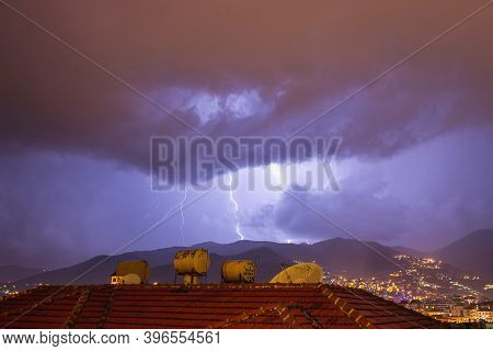 Strong Thunder-storm Above Night Mountains And City. Large Bright Lightning Close Up. Mediterranian