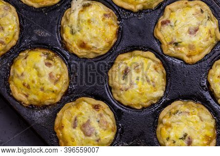 Mini Quiches With Bacon, Egg, Cheese And Parsley In Baking Tin - Savoury Tartlets  Top View