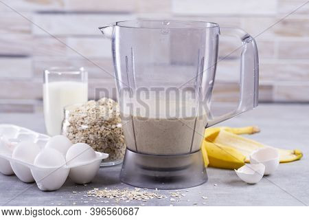Oat Pancakes With Banana. Step By Step Cooking Process. Ingredients Top View. Bananas, Milk, Eggs, O