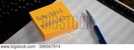 Close-up Of A Memory Stick With The Word Scheduled Maintenance. Selective Focus. Calendar Scheduler