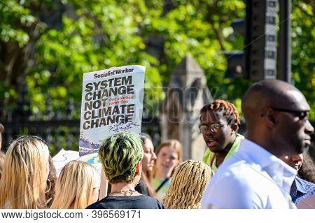 London - September 20, 2019: Climate Change Protester Holding A Banner At An Extinction Rebellion Pr