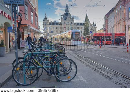 Graz, Austria - November 18, 2019: Rush Hour With Lots Of People, Trams, Cyclist And Cars In Main Sq