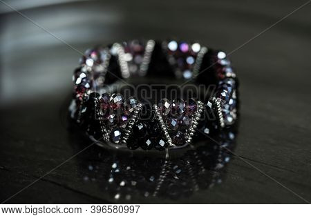 Beautiful And Unique Black Bracelet On A Black Background. Bracelet For Woman.