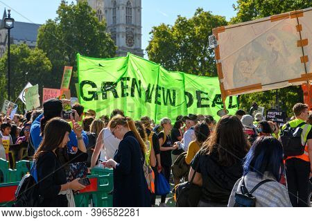 London - September 20, 2019: Climate Change Protesters Holding A Banner At An Extinction Rebellion D