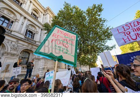 London - September 20, 2019: A View Looking Up At Climate Change Banners At An Extinction Rebellion