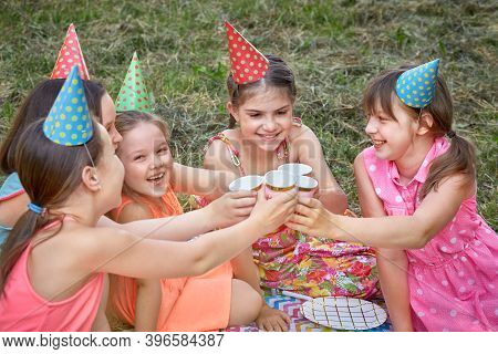 Happy Girls In A Party Hat Are Celebrating Their Birthday With Their Girlfriends