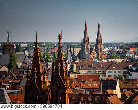 Aerial View Of The City Of Strasbourg. Sunny Day. Red Tiled Roofs. Reformed Church Saint Paul