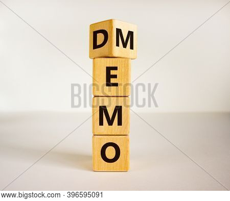 Turned Cube And Changed The Word 'demo' To 'memo'. Beautiful White Background. Business And Demo And