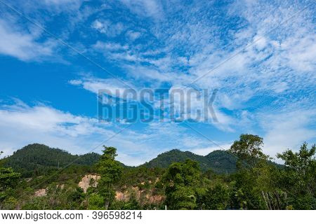 Mountains With Beautiful Blue Sky And White Clouds In A Noon Time