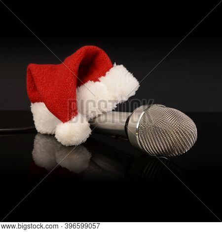 A Christmas Santa Hat With A Microphone For Singing During The Holidays.