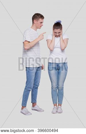Couple Having A Fight. Man Screaming At Girl. Man Is Not Satisfied. Couple Standing Isolated. Girl C