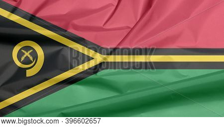 Fabric Flag Of Vanuatu. Crease Of Vanuatu Flag Background, Red And Green With Black And Yellow Color