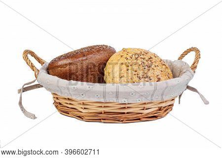 Bakery Product. Bread. Beautiful Composition With Wicker Basket And Different Bread On A White Backg