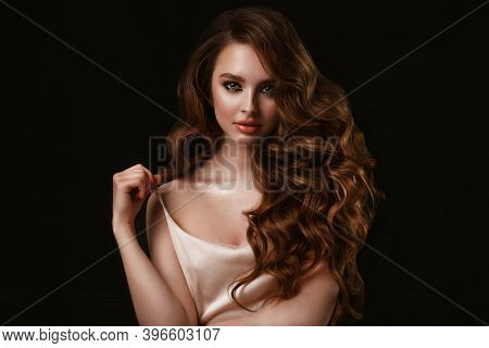 Beauty Portrait Of Elegant Young Woman. Glamour Makeup. Face Of The Beautiful Woman With Long Brown