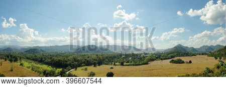 Panorama Image Of Green Trees And Mountain Hill With Blue Sky And White Clouds In Background.