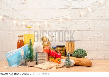 Christmas Donation Box - Food Donations On Light Background With Copyspace - Pasta, Fresh Vegatables