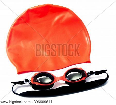 Rubber Hat And Glasses For Swimming In The Pool Isolated On A White Background. Swimming Diving Snor