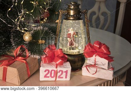 2021 Figures On Box. Christmas Gift Boxes With Red Ribbon, New Year Tree With Decorations, Magic Lan