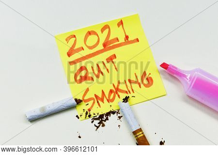 New Years Resolution 2021 Quit Smoking Concept With Breaking A Cigarette