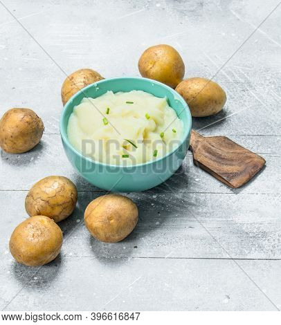 Mashed Potatoes In A Bowl . On A Rustic Background.