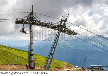 Man Make A Photo A Construction Site Of Chairlift In A Mountain Region In Summer.