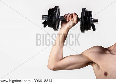 Man Hand Holding Dumbbell In Hand. Skinny Guy Hold Dumbbells Up In Hands. A Thin Man In Sports With