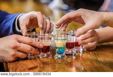 Friends Drink Shot Or Liqueur. Five Glasses Of Alcohol.tequila Shots, Vodka, Whisky, Rum. Cocktail A