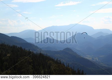Great Paragliding Moment: Paragliding Concept / Paraglider Flying In Beautiful Natural Mountain Land