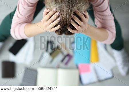 Stressed Woman Bent Over Bank Cards And Checks. Womens Spending And Family Budget Concept