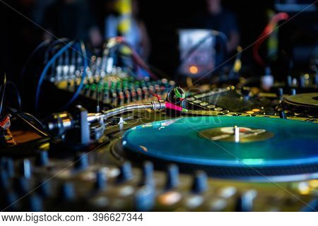 Professional Dj Turntable.vinyl Record Player On Stage In Night Club.retro Analog Disc Audio Equipme