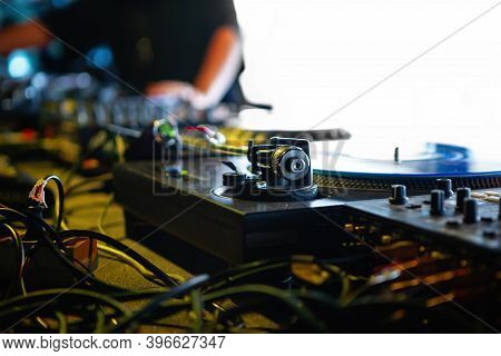 Professional Dj Turntable Player On Stage In Night Club.turntables Tonearm In Focus.retro Analog Aud