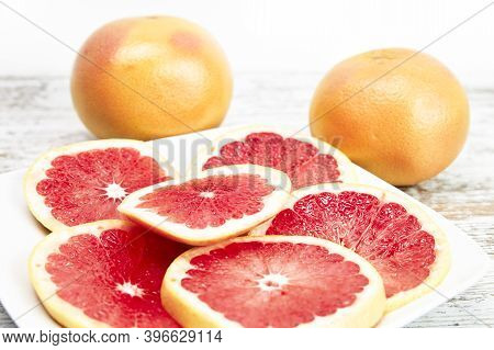 Grapefruit Isolated On Wooden Table. Freshly Harvested Grapefruit. Healthy Fruit Concept