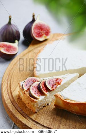 Cheesecake With Fig. Delicious Classic Cheesecake Served With Fresh Figs, And Fig With Selective Foc