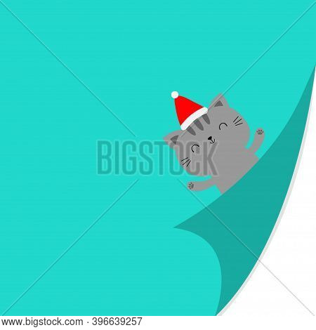 Cute Cat Kitten Face Holding Hands Up. Fold Page Corners. Red Santa Hat. Merry Christmas. Curled Pap