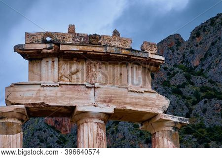 Details Of Tholos Of Ancient Greek Goddess Athena Pronaia In Delphi, Greece. Relieves Of Amazon And