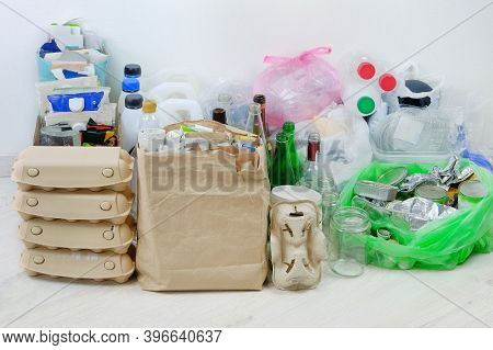 Various Garbage For Recycling. Paper, Cardboard, Metal And Glass Prepared For Recycling. Waste To Be