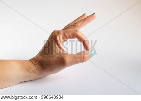Hand In Ok Position On White Background