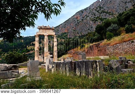 Ruins Of Tholos Of Ancient Greek Goddess Athena Pronaia In Delphi, Greece. Doric Columns. Unesco Wor