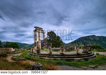 Ruins Of Tholos Of Ancient Greek Goddess Athena Pronaia In Delphi, Greece. Parts And Restored Doric