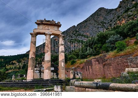 Ruins Of Tholos Of Ancient Greek Goddess Athena Pronaia In Delphi, Greece. Three Doric Columns With