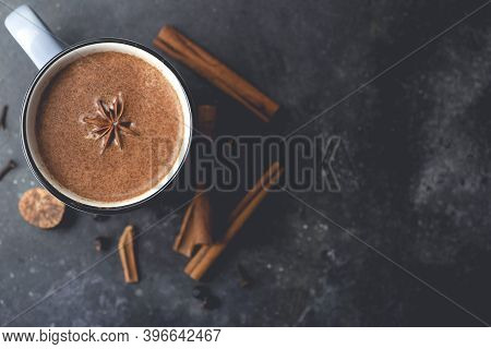 Masala Tea (masala Chai). Hot Indian Drink Based On Milk And Tea With The Addition Of Spices And Her