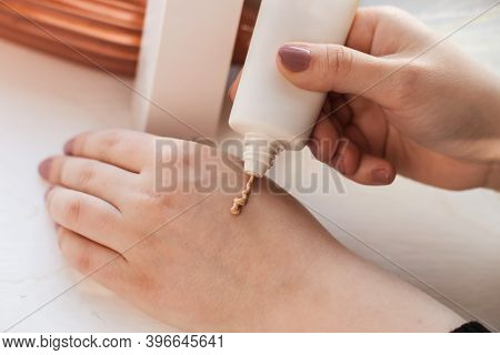Female Hands With Applied Hand Cream In Tube. Closeup