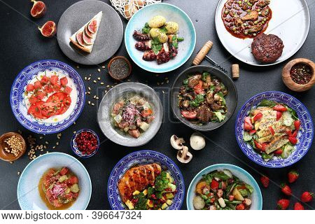 Table Food Top View. Set Of Dishes On The Table. International Mix Set Foods. Vegeterian And Meat An