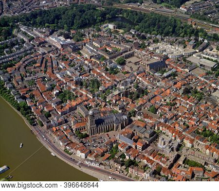Deventer, Holland, July 11 - 1990: Historical aerial photo of the city Deventer situated on the east bank of the river IJssel and Lebuinuskerk in front in the province Overijssel