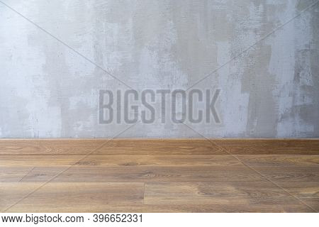 Empty Room With Dark Wooden Floating Laminate Flooring. House Interior, Bedroom Or Living Room Space
