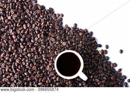 Coffee Beans And Cup Of Coffee Isolated On White Background